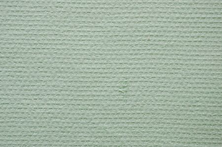 Embossed abstract pattern on a light green paper