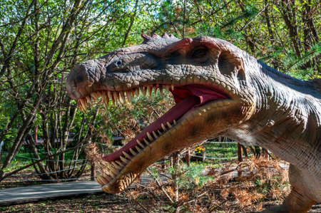 Russia, Moscow - September 29, 2018: Dinosaur in the park in sunny weather