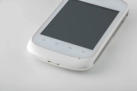 White smartphone with touch buttons and icons with blank black screen. On white background