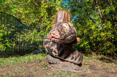 Russia, Moscow - September 29, 2018: Huge snake monster prehistoric full size model