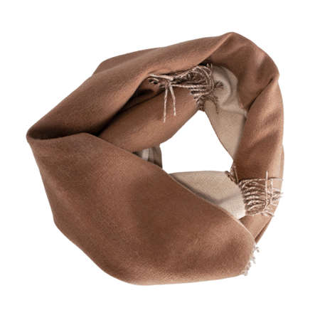 Long scarf in light beige and brown colors rolled into a circle. Top view isolated on white