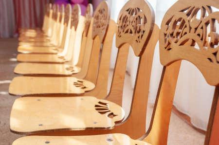 Group of wooden chairs for preschoolers in kindergarten