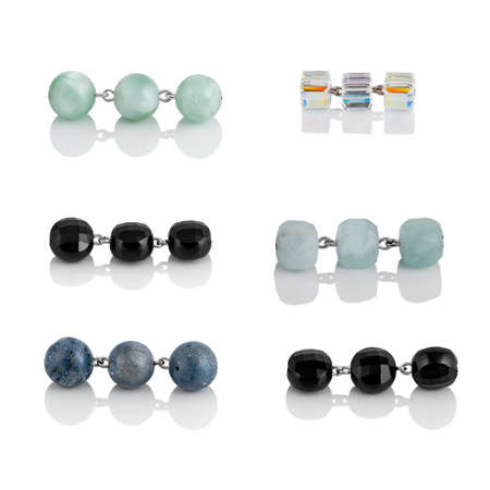 A set of natural gemstones and beads for jewelry and bijouterie. Template for designers and layouts. Isolated on white with reflection Standard-Bild