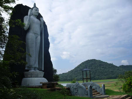Giant stone statue of the standing Great Buddha in Sri Lanka