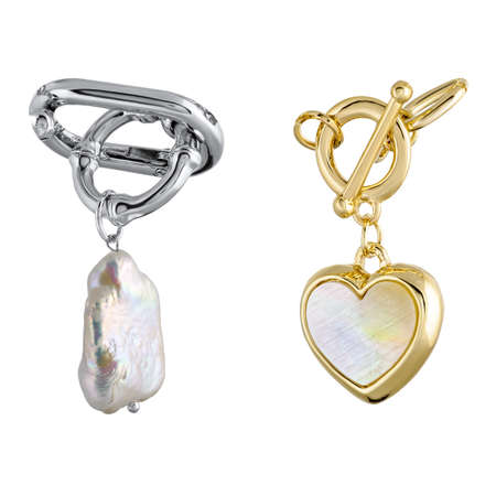 Pendants in yellow and white gold with pearls and mother-of-pearl on a white background