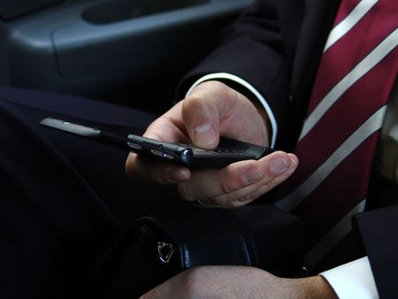 makes: Businessman makes a call by cell phone in car Stock Photo
