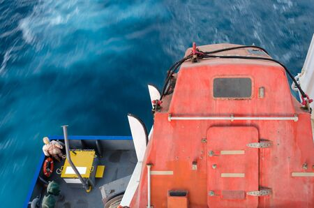 Free fall lifeboat on a stern of the vessel Standard-Bild