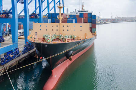 Mombasa, Kenya - February 24: Container terminal with mooring vessel in the Mombasa on February 24, 2018 in Mombasa, Kenya. Editöryel