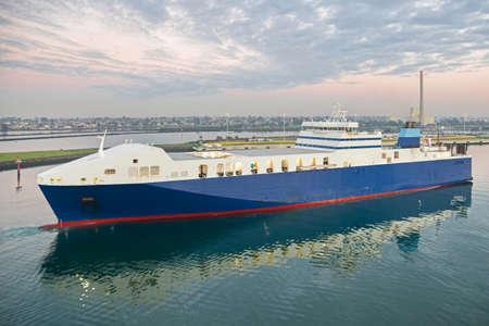 Melbourne, Australia - July 5: Cargo vessel in port of Melbourne on July 5, 2019 in Melbourne, Australia.