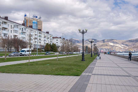 Novorossiysk, Russia - March 25: Seafront against the background of mountains in Novorossiysk on March 25, 2019 in Novorossiysk, Russia. Editöryel