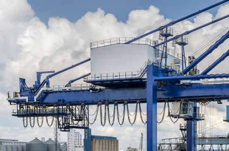 Dar es Salaam, Tanzania - February 21: Cargo crane of the container terminal in port of Dar es Salaam on February 21, 2018 in Dar es Salaam, Tanzania. Editöryel
