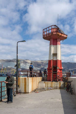 Novorossiysk, Russia - March 25: Lighthouse of the west mole in Novorossiysk on March 25, 2019 in Novorossiysk, Russia.