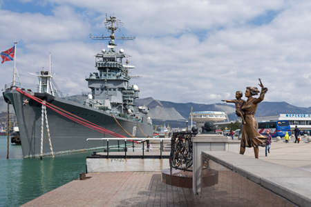 Novorossiysk, Russia - March 25: Navy ship and woman with child waiting for a seaman sculpture in Novorossiysk on March 25, 2019 in Novorossiysk, Russia.