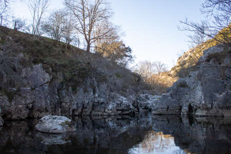 In the province of Burgos, in Espinosa de los Monteros, there are bathing areas where you can go swimming if you dare with the cold water of a mountain river. At sunset the colors are more beautiful. Girls walking along nature trails.