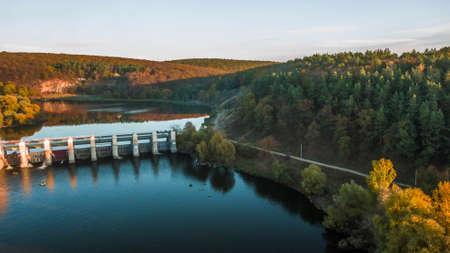 Water rushing through gates at a dam Stock Photo