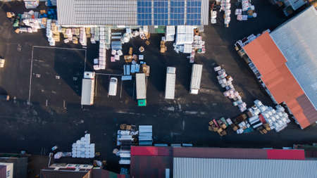 Aerial Shot of Industrial Warehouse Loading Dock where Many Trucks