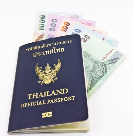 baht: Thailand official passport and Thai money  Stock Photo