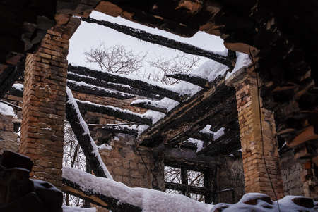 snow break: Ruined ceiling in abandoned factory workshop