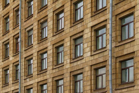 architectonics: Windows in a row on facade of apartment building Stock Photo