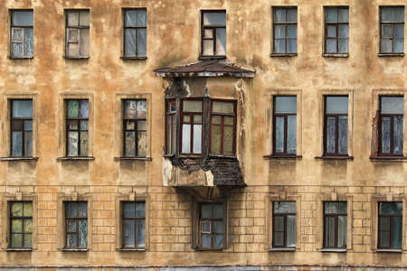 architectonics: Windows in a row and bay window on facade of apartment building Stock Photo