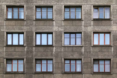 Windows in a row on facade of apartment building Stock Photo