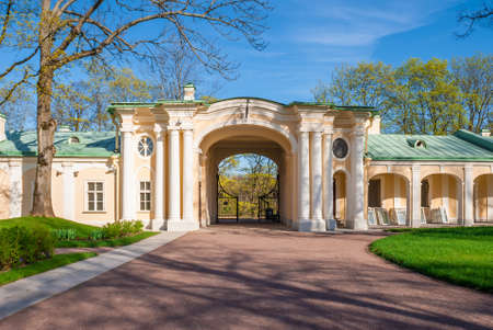 front  or back  yard: Lomonosov, Leningrad Oblast, Russia - May 10, 2015: Courtyard and arch with gate of Bolshoy Menshikovskiy palace. Located in Oranienbaum park on the shore of Gulf of Finland Editorial