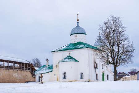 st nicholas cathedral: St. Nicholas Cathedral and fortress wall of Izborsk fortress in winter scene, Pskov Oblast