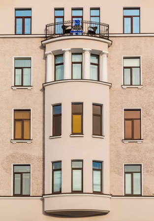 many windows: Many windows in row and bay window on facade of urban apartment building front view, St. Petersburg, Russia