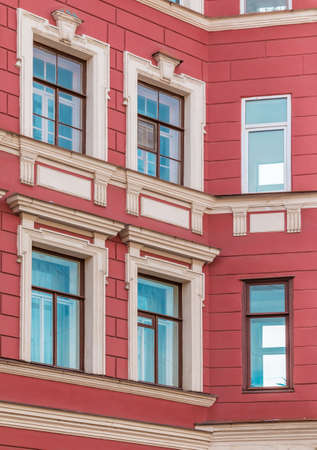 architectonics: Several windows in row on corner of facade of urban apartment building front view, St. Petersburg, Russia Stock Photo