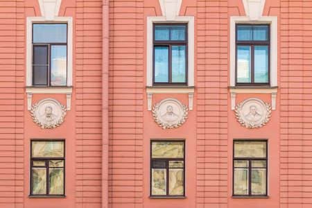 architectonics: Several windows in row on facade of urban apartment building front view, St. Petersburg, Russia