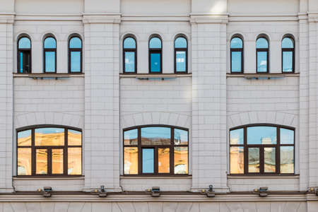 architectonics: Several windows in row on facade of urban building front view, St. Petersburg, Russia