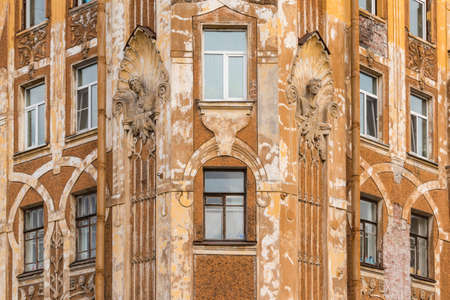 architectonics: St. Petersburg, Russia - March 10, 2016: Several windows in row on corner of facade of urban apartment building front view Editorial