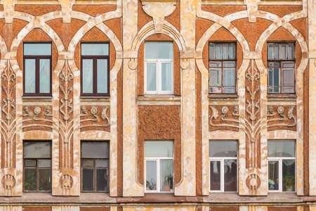architectonics: St. Petersburg, Russia - March 10, 2016: Several windows in row on facade of urban apartment building front view Editorial