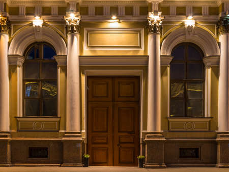 St. Petersburg, Russia - May 30, 2016: Door and two windows on nignt illuminated facade of NIVavilov Institute of Plant Genetic Resourses front view Editorial