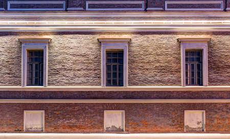 several: Several windows in a row on night illuminated facade