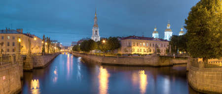 st nicholas: Night view on illuminated Kryukov Canal, Griboedov Canal and St. Nicholas Naval Cathedral, St. Petersburg, Russia Stock Photo