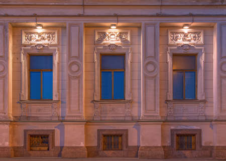 manuscripts: St. Petersburg, Russia - August 4, 2016: Three windows in a row on night illuminated facade of the Institute of Oriental Manuscripts front view
