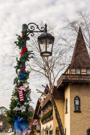 14: Helen, Georgia, USA - December 14, 2016: The street light with Christmas decorations on the Main Street Editorial