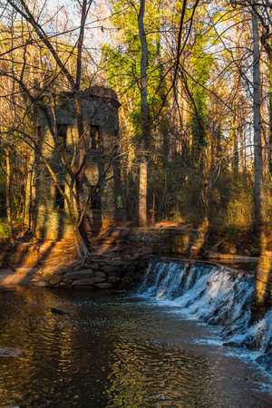 Spillway waterfall and the tower in the Lullwater Park, Atlanta, USA