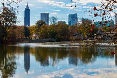 View of Lake Clara Meer, bridge with gazebo and Midtown Atlanta in sunny autumn day, USA