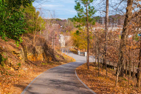 The asphalt footpath leading to the Boardwalk in the Piedmont Park in autumn day, Atlanta, USA