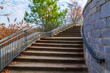 grate: Curved staircase to Grand Arbor in the Piedmont Park in sunny autumn day, Atlanta, USA
