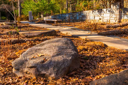 The big boulder closeup and footpath in the Stone Mountain Park in sunny autumn day, Georgia, USA Stock Photo