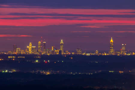 The beautiful view of illuminated Midtown Atlanta from the Stone Mountain at twilight with red sky, Georgia, USA