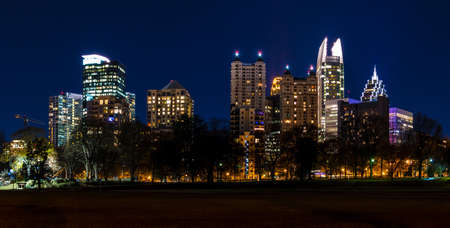 Dusk view of illuminated skyscrapers of Midtown Atlanta from the Piedmont Park, USA