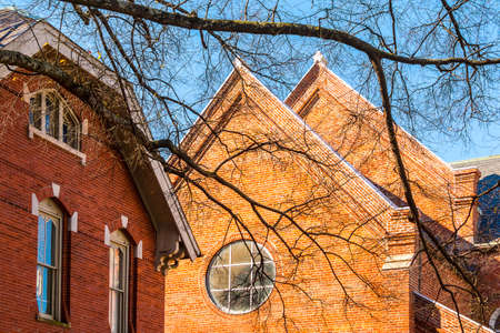Part of brick facade of Catholic Shrine of the Immaculate Conception in sunny autumn day, Atlanta, USA