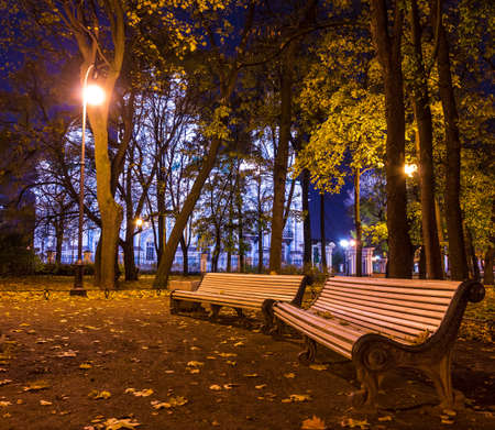 Night autumn view of illuminated St. Nicholas Naval Cathedral and benches in Nikolskiy garden, St. Petersburg, Russia Stock Photo