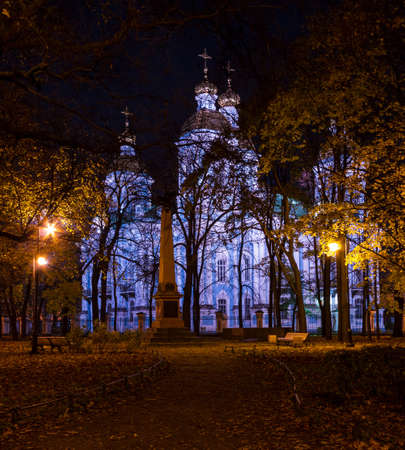 Night autumn view of illuminated St. Nicholas Naval Cathedral and Nikolskiy garden, St. Petersburg, Russia Stock Photo
