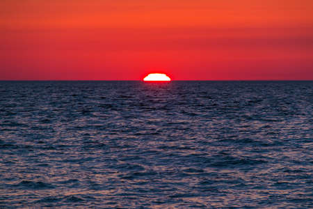 The edge of the sun seen from the horizon at sunset