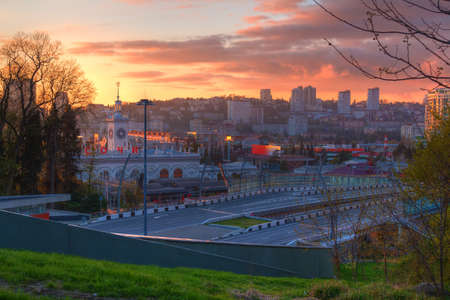 Aerial view of city and highway Doubler of Kurortnyy Prospekt at sunset, Sochi, Russia Stock Photo